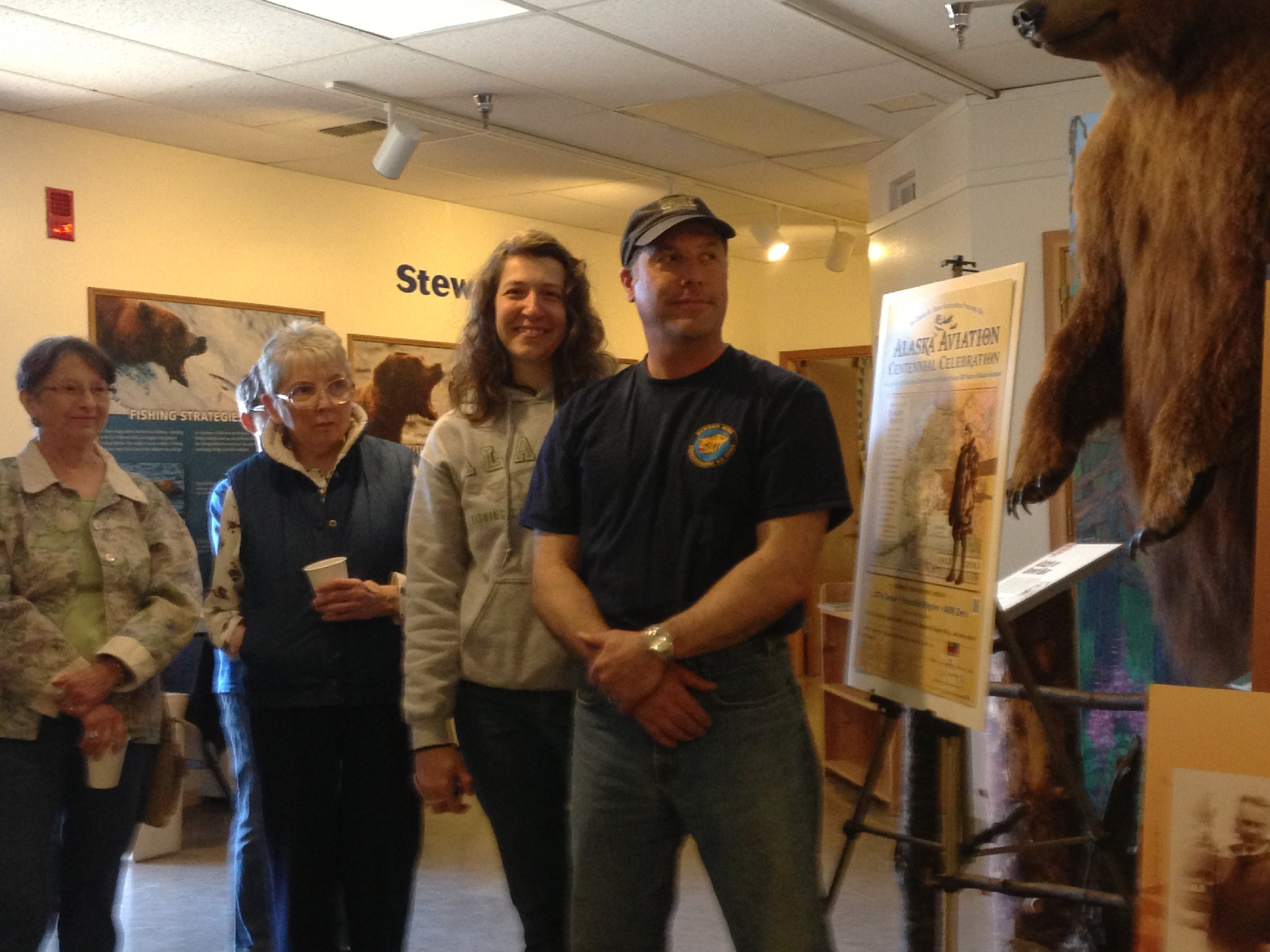 Pilot Jeff Sever and wife Stacey at the Pratt Museum with guests