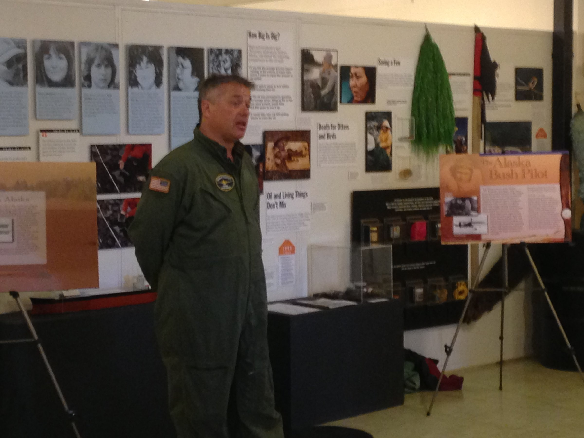 Chuck Miller discussing the history of aviation in Alaska with Pratt Museum guests.